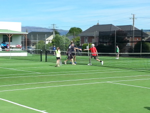 Opponents shake helds following a match in the Parent & Child Tournament